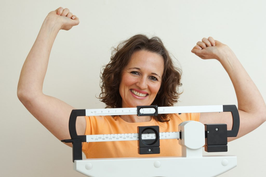 woman having achieved weight loss with weight loss hypnotherapy