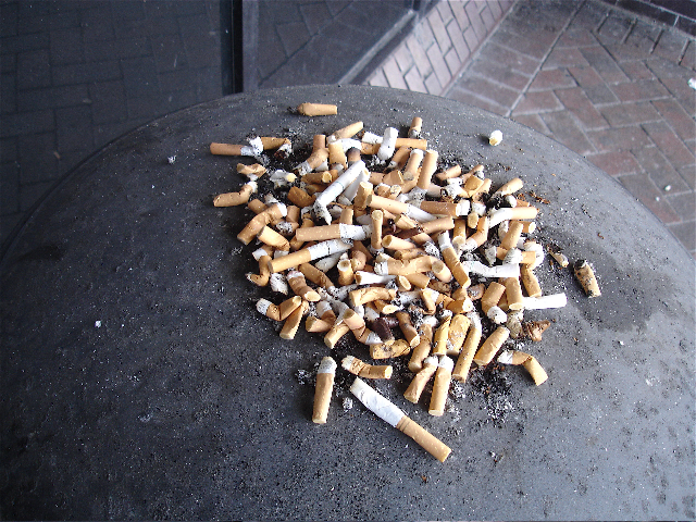 cigarette butts overflowing outside airport stop smoking hypnotherapy